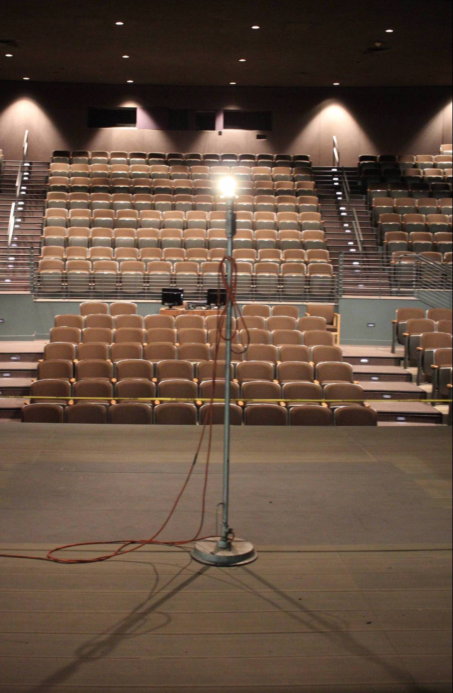 Light pole on stage in the middle of an empty theatre